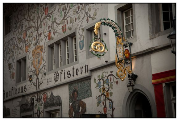 Mural and elaborate sign with gold pretzel, Lucerne, Switzerland.