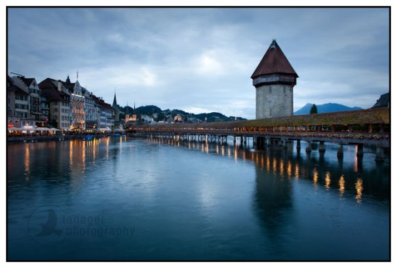 The Chapel Bridge and Old Town Lucerne at dusk, Switzerland.