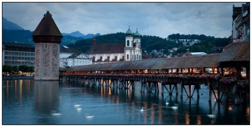 Panorama of the Chapel Bridge and Jesuit Church in Lucerne, Switzerland.