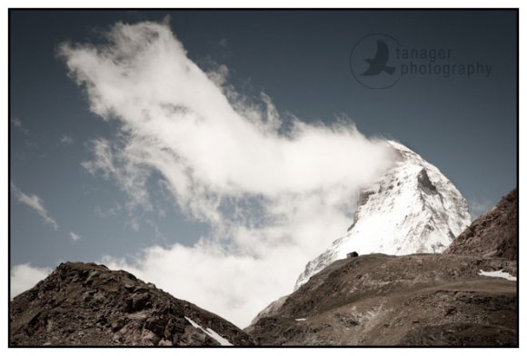 A banner cloud drapes around the summit of the Matterhorn near Zermatt, Switzerland.