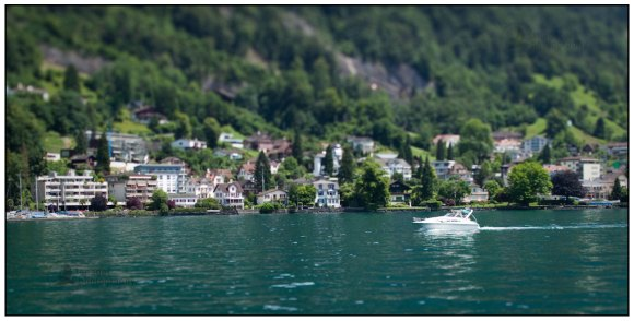 Vitznau and a motorboat on Lake Lucerne, Switzerland