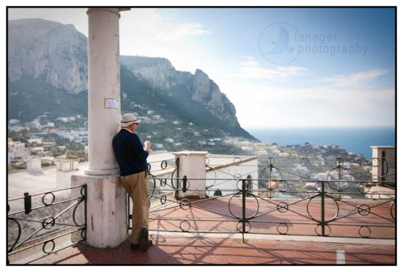 A man surveys the island of Capri, Campagna, Italy