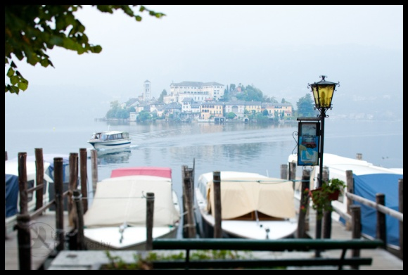 Boat and Isola San Giulio seen from Orta San Giulio, Italy