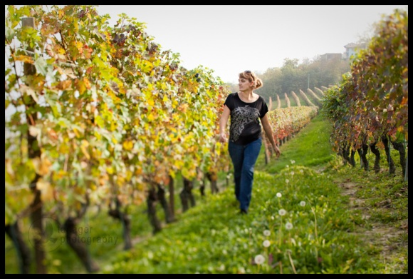 woman walking through vineyard, Barolo, La Morra, Italy